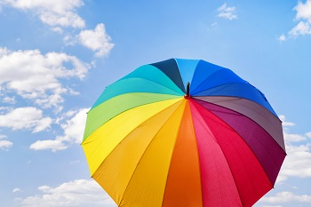 colorful umbrella with blue sky in the background